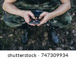 man dressed in military clothes ...   Shutterstock . vector #747309934