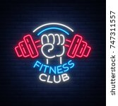 fitness  gym logo sign in neon... | Shutterstock .eps vector #747311557