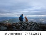 man and dog outdoors  in the... | Shutterstock . vector #747312691