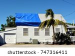 blue plastic tarpaulin... | Shutterstock . vector #747316411