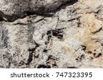 ancient greek rough rock texture | Shutterstock . vector #747323395