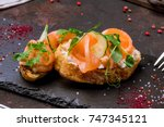 bruschetta with salmon | Shutterstock . vector #747345121
