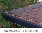 gutters on shingle roof without ... | Shutterstock . vector #747351325