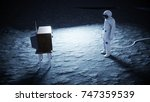 alone astronaut on the moon...   Shutterstock . vector #747359539