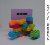 Small photo of Algebra word with toys