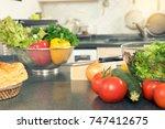 home modern kitchen prepare raw ... | Shutterstock . vector #747412675