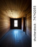 Antique Wooden Spooky Abandoned Farm House Neglected Hallway with converging lines to window light source - stock photo