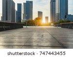 empty wooden footpath front... | Shutterstock . vector #747443455