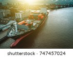 container ship in import export ...   Shutterstock . vector #747457024