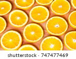 oranges are cut into slices and ... | Shutterstock . vector #747477469