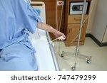 close up hand pushing nurse... | Shutterstock . vector #747479299