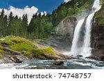 Alpine Waterfall In Mountain...