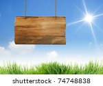 hanging wooden sign with sun... | Shutterstock . vector #74748838