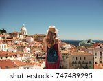 young woman looking at lisbon... | Shutterstock . vector #747489295