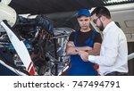 mechanic and flight engineer... | Shutterstock . vector #747494791