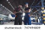 two flight engineers walking... | Shutterstock . vector #747494809