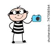 cartoon criminal with digital...   Shutterstock .eps vector #747508564