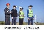 engineers standing with virtual ... | Shutterstock . vector #747533125