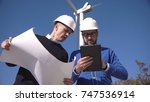 two engineers discussing a... | Shutterstock . vector #747536914