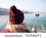 young woman photographing selfie | Shutterstock . vector #747540571