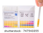 Small photo of How to measure the acidity and alkalinity of a solution of pH with paper. White background