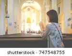 asian woman praying in the... | Shutterstock . vector #747548755