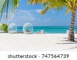 outdoor tropical beach scene... | Shutterstock . vector #747564739