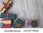 christmas gift boxes on wood... | Shutterstock . vector #747577909