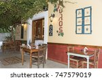 greek taverna in crete  greece. ... | Shutterstock . vector #747579019
