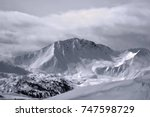 moody snow covered mountains in ... | Shutterstock . vector #747598729