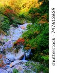 Small photo of autumn scenery of ciyun bridge waterfall in cien.with sunrise along the trails of taroko national park,sunshine on fiery maple,colorful stone and waterfall compose the chinesen aesthetic elegant sense