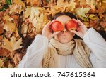 Woman With Red Apple In Autumn...