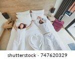 happy couple in luxury hotel... | Shutterstock . vector #747620329