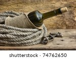 bottle wrapped with rope... | Shutterstock . vector #74762650