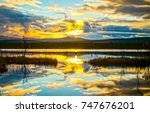 sunset lake reflection sky... | Shutterstock . vector #747676201