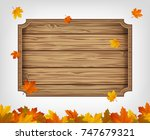 autumn background with maple... | Shutterstock .eps vector #747679321