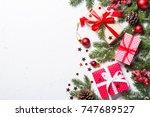 christmas background. snow fir... | Shutterstock . vector #747689527