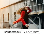 Small photo of Fashion show concept. The lady walking forward. Waving in the wind hair. Emotional portrait. Red jacket and emotional portrait. joy and obstinacy.