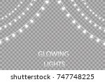 glowing lights for holidays.... | Shutterstock .eps vector #747748225