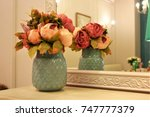 a bouquet of flowers in a vase... | Shutterstock . vector #747777379