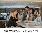 small group of coworkers are... | Shutterstock . vector #747782674