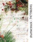 christmas background with fir... | Shutterstock . vector #747786541