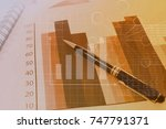 financial graph analysis concept | Shutterstock . vector #747791371