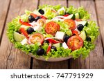 bowl of fresh salad with... | Shutterstock . vector #747791929