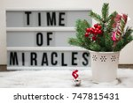 Small photo of Christmas composition with festive accoutrement and board with phrase, sentence time of miracles