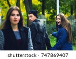 disloyal man walking with his...   Shutterstock . vector #747869407