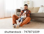 family  parenthood and people... | Shutterstock . vector #747871039