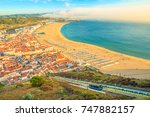 view of nazare cabins train... | Shutterstock . vector #747882157