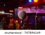microphone on stage against a... | Shutterstock . vector #747896149