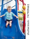 this boy is playing on the slide | Shutterstock . vector #747909661